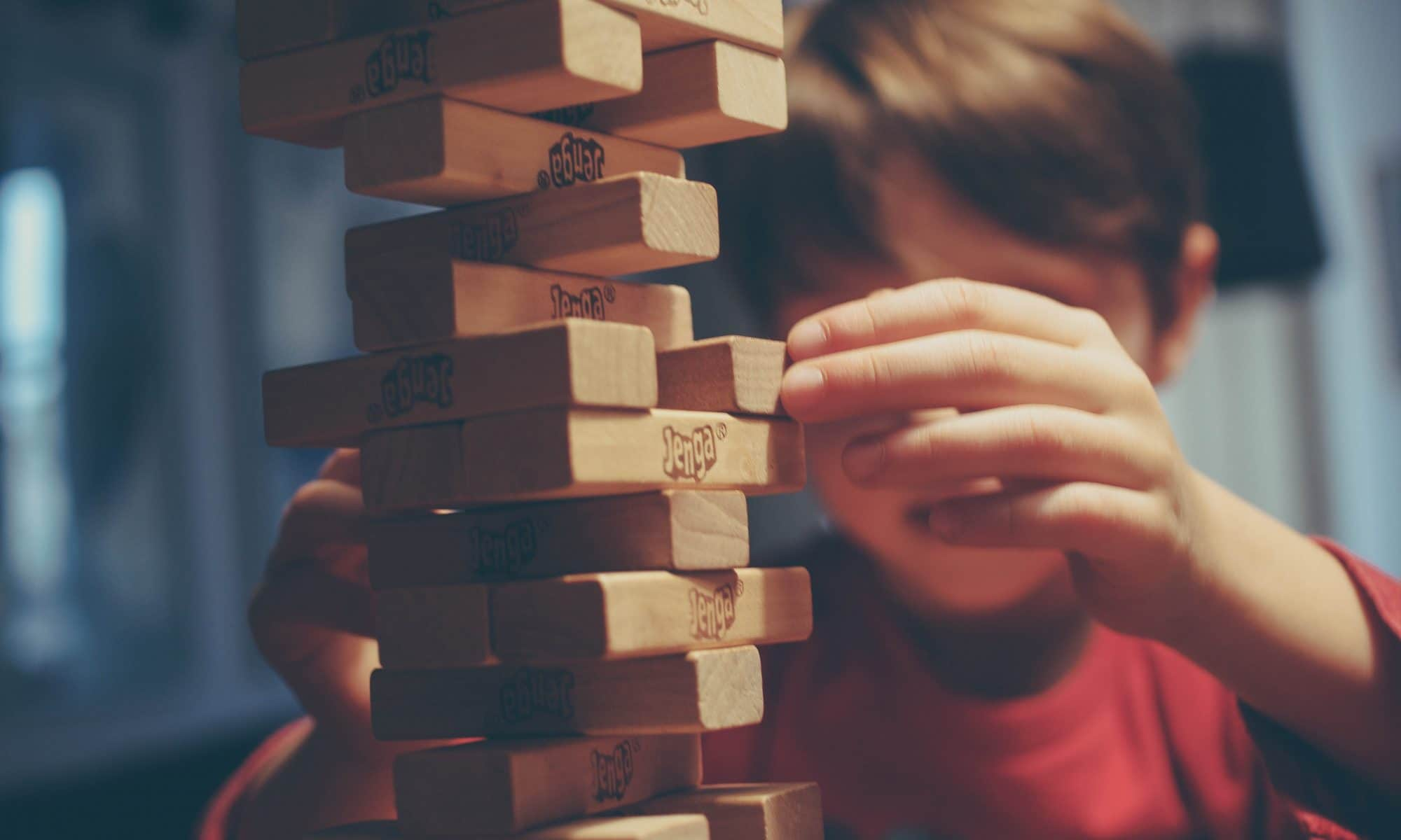 Child Playing Jenga